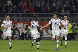 Lyon's Yoann Gourcuff, second right, celebrates with his teammates after he scored a goal against Marseille during their French League One soccer match at Gerland stadium, in Lyon, central France, Sunday, Oct. 26, 2014. (AP Photo/Laurent Cipriani)
