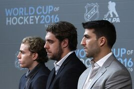 Chicago Blackhawks' Patrick Kane, left, Los Angeles Kings' Anze Kopitar, center, and Boston Bruins Patrice Bergeron listen as NHL Commissioner Gary Bettman announces the return of the World Cup of Hockey in 2016 in Toronto, during a news conference at Nationwide Arena in Columbus, Ohio, before the NHL All-Star hockey skills competition, Saturday, Jan. 24, 2015. NHL partners Sportsnet and TVA have been awarded the exclusive media rights to broadcast the 2016 World Cup of Hockey in Canada. THE CANADIAN PRESS/AP/Gene J. Puskar