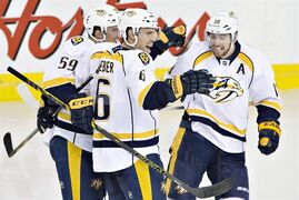 Nashville Predators' Roman Josi (59), Shea Weber (6) and James Neal (18) celebrate a goal against the Edmonton Oilers during third period NHL hockey action in Edmonton, Alta., on Wednesday October 29, 2014. THE CANADIAN PRESS/Jason Franson