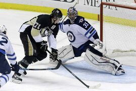 Pittsburgh Penguins' Evgeni Malkin can't get to a rebound in front of Winnipeg Jets goalie Al Montoya during the first period of an NHL game at the Consol Energy Center in Pittsburgh Sunday. The Penguins won 6-5.