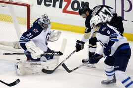 Pittsburgh Penguins' Simon Despres (47) can't get a shot past Winnipeg Jets goalie Ondrej Pavelec (31) with Jacob Trouba (8) defending during the first period in Pittsburgh Tuesday.