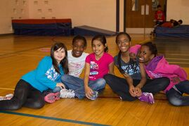 (left to right) Boys and Girls Club of Winnipeg members Sophia Johnston, Anne Adewumi, Franz DeLeon, Hope Akinmade, Posi Sogeke take a breather before a game of dodgeball.