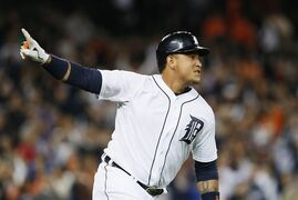 Detroit Tigers' Miguel Cabrera celebrates hitting a walk off one-run single against the Chicago White Sox in the ninth inning of a baseball game in Detroit Tuesday, Sept. 23, 2014. Detroit won 4-3. (AP Photo/Paul Sancya)