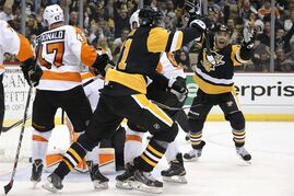 Pittsburgh Penguins' Pascal Dupuis, right, celebrates his goal during the second period of an NHL hockey game against the Philadelphia Flyers in Pittsburgh, Wednesday, Oct. 22, 2014. (AP Photo/Gene J. Puskar)