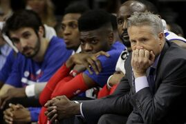 Philadelphia 76ers head coach Brett Brown, right, watches from the bench during the second half of an NBA basketball game against the Los Angeles Clippers, Friday, March 27, 2015, in Philadelphia. Los Angeles won 119-98. (AP Photo/Matt Slocum)