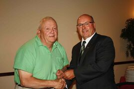 (Left) Macdonald reeve Rodney Burns received a long service award for 25 years in the fall of 2013 from Association of Manitoba Municipalities' president and Macdonald councillor and deputy reeve Doug Dobrowolski. Burns has been in hospital for some time, and Macdonald council decided to move part of its August meeting to Grace Hospital so that he could still preside over it.