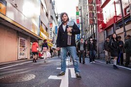 Winnipeg professional wrestler Kenny Omega, a star on the Japanese-pro wrestling circuit, poses in Tokyo's Akihibara district with his IWGP Jurnior Heavyweight Championship Belt.