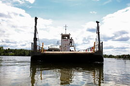In this file photo from last year, a barge leaves the dock at Shoal Lake 39 First Nation and heads across Shoal Lake to Shoal Lake 40 First Nation, a community that was separated from the mainland after land was flooded a hundred years ago.