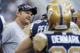 Winnipeg Blue Bombers head coach Mike O'Shea seems a bit perplexed whilst in conversation with one his players on Saturday night.