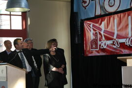 Campaign cabinet members watch as Jeff Zabudsky gives the signal to see United Way's achievement to date.