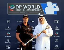 Henrik Stenson from Sweden, left, with Mohammed Sharaf holds the trophy of the DP World Golf Championship as he poses for a picture after the final round of DP World Golf Championship, in Dubai, United Arab Emirates, Sunday, Nov. 23, 2014. Stenson has successfully defended his DP World Tour Championship title at the European Tour's season-ending event.(AP Photo)