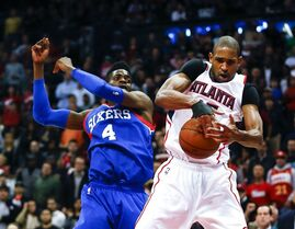 Atlanta Hawks center Al Horford (15) grabs a rebound in front of Philadelphia 76ers center Nerlens Noel (4) in the second half of an NBA basketball game Saturday, Jan. 31, 2015, Atlanta won 91-85 and extended their winning streak to 19 games.(AP Photo/John Bazemore)