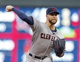 Cleveland Indians pitcher Corey Kluber throws against the Minnesota Twins in the first inning of a baseball game, Friday, April 17, 2015, in Minneapolis. (AP Photo/Jim Mone)