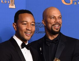 """FILE - In this Jan. 11, 2015 file photo, performers John Legend, left, and Common pose in the press room after the award for best original song """"Glory"""" in a film for """"Selma"""" at the 72nd annual Golden Globe Awards in Beverly Hills, Calif. The pair will perform their Oscar-nominated song """"Glory"""" at the Academy Awards. (Photo by Jordan Strauss/Invision/AP, File)"""