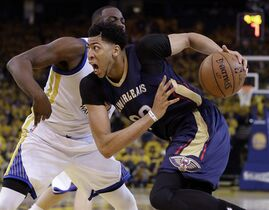 New Orleans Pelicans' Anthony Davis, right, drives past Golden State Warriors' Draymond Green during the second half in Game 1 of the NBA basketball playoffs Saturday, April 18, 2015, in Oakland, Calif. Golden State won 106-99. (AP Photo/Marcio Jose Sanchez)