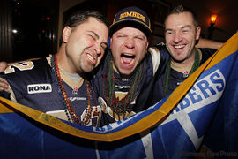From left: James Cameron, William Reid and John Robinson take part in the Grey Cup festivities in Vancouver Saturday.