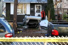 The aftermath of a multi-car crash on Saturday morning outside 547 Banning Street. One car hurtled into the front yard earlier and was left overturned with its roof ripped off. One witness reported two people extracted themselves from an upside down vehicle and tried to walk away.  Oct 25,  2014 Ruth Bonneville / Winnipeg Free Press