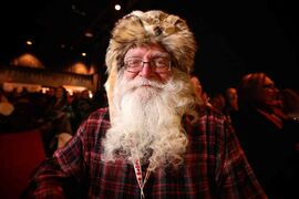 Roger Prince, 72, waits to compete in the 33rd beard growing contest at Festival du Voyageur Friday. Prince has won first place in the competition several times over the years.