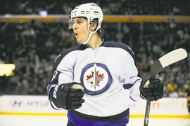Mark Scheifele celebrates his first of two second-period goals Tuesday.