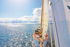 Passengers relax on deck as they bond in a real way over the course of their six-day voyage.