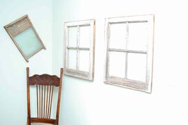 Windows from the original barn, an antique chair and a washboard are part of the barn's rustic chic.