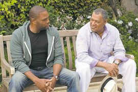 Anthony Anderson (left) and Laurence Fishburne in a scene from the new comedy Black-ish.