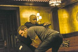 McCall (Denzel Washington, top) takes out a thug (Nash Edgergton) in the Equalizer.
