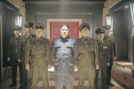 Randall Park, centre, as Kim Jong Un in The Interview. Below, Kim Jong Il as a puppet, in 2004's Team America: World Police.