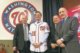 Scott Boras client Max Scherzer shows off his new Washington Nationalos uniform during an introductory news conference at Nationals Park on Wednesday.   21, 2015, in Washington. Scherzer signed a $210 million, seven- year contract to join the Nationals. From left, Nationals manager Matt Williams, Scherzer, Scherzer�s agent Scott Boras, and Nationals general manager Mike Rizzo. (AP Photo/