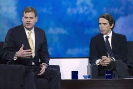 Former Canadian Foreign Minister John Baird, left, and former Spanish Prime Minister Jose Maria Aznar speak at the 2015 American Israel Public Affairs Committee (AIPAC) Policy Conference in Washington, Monday, March 2, 2015. (AP Photo/Cliff Owen)