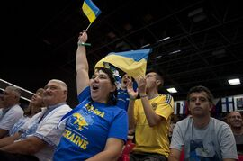 A Ukraine fan cheers her team in the Basketball World Cup matches which beginning today, in Bilbao northern Spain, Saturday, Aug. 30, 2014. The 2014 Basketball World Cup competition take place in various cities in Spain from Aug. 30 through to Sept. 14. (AP Photo/Alvaro Barrientos)