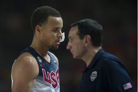 United States's Stephen Curry, leaves the pitch as crosses beside coach Mike Krzyzewski, right, during the Group C Basketball World Cup match against Finland in Bilbao northern Spain, Saturday, Aug. 30, 2014. The 2014 Basketball World Cup competition will take place in various cities in Spain from Aug. 30 through to Sept. 14. (AP Photo/Alvaro Barrientos)