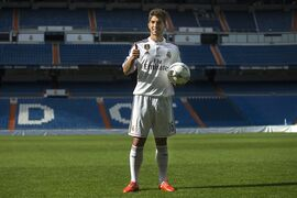 Brazilian international soccer player Lucas Silva, poses for photographers during his official presentation at the Santiago Bernabeu stadium in Madrid, Spain, Monday, Jan. 26, 2015, after signing for Real Madrid. (AP Photo/Andres Kudacki)