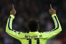 Barcelona's Neymar celebrates his second goal during a second leg quarterfinal Copa del Rey soccer match between Atletico de Madrid and FC Barcelona at the Vicente Calderon stadium in Madrid, Spain, Wednesday, Jan. 28, 2015. (AP Photo/Andres Kudacki)
