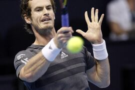 Andy Murray returns a ball during the final match against Tommy Robredo from Spain, at ATP 500 World Tour Valencia Open tennis tournament at the agora building of the Ciudad de las Artes y las Ciencias in Valencia, Spain, Sunday, Oct. 26, 2014. (AP Photo/Alberto Saiz)