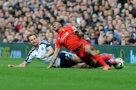 Liverpool's Raheem Sterling, right, is tackled by West Brom's Craig Dawson during the English Premier League soccer match between West Bromwich Albion and Liverpool at the Hawthorns, West Bromwich, England, Saturday, April 25, 2015. (AP Photo/Rui Vieira)