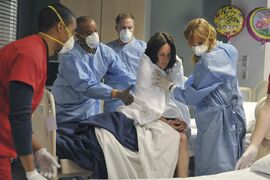Above, Dr. Catherine Black (played by Kelly Reilly, right) and her team attend to a patient.