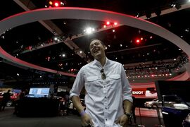 Chris Valasek, poses for a picture at the during the Los Angeles Auto Show on Wednesday, Nov. 19, 2014, in Los Angeles. Valasek, who helped catapult car hacking into the public eye when he and a partner revealed last year they had been able to control a 2010 Toyota Prius and 2010 Ford Escape by plugging into a port used by mechanics. (AP Photo/Chris Carlson)
