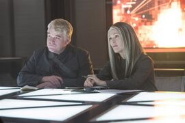 This photo released by Lionsgate shows, Philip Seymour Hoffman, left, as Plutarch Heavensbee and Julianne Moore as President Coin in a scene from the film,
