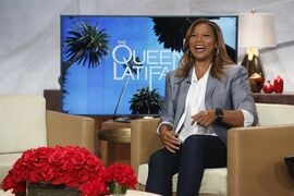 In this undated photo provided by Sony Pictures Television, talk show host, Queen Latifah, laughs on the set of