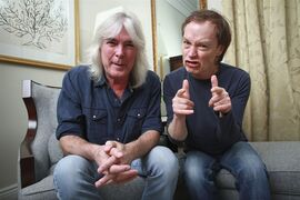 FILE - In this Nov. 13, 2014 file photo, members of the rock band AC/DC, bassist Cliff Williams, left, and guitarist Angus Young pose for a portrait in promotion of their upcoming album,