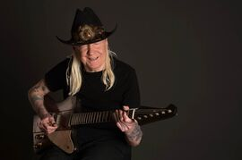"""This March 30, 2013 photo provided by Kid Logic Media shows Johnny Winter at the Carriage House Recording Studios in Stamford, Conn. Winter died in a hotel room just outside Zurich at age 70 in July 2014. The Texas blues legend had just finished recording """"Step Back,"""" an album of mainly blues standards released posthumously last month, that spent three weeks atop Billboard's blues albums chart and features Eric Clapton, Dr. John and Joe Perry. (AP Photo/Kid Logic Media, Michael Weintrob)"""
