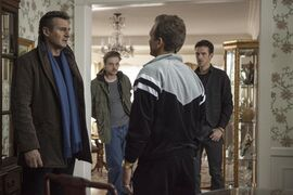 "This photo released by Universal Pictures shows, from left, Liam Neeson, as Matt Scudder, Boyd Holbrook as Peter Kristo, Sebastian Roche as Yuri Landau, and Dan Stevens as Kenny Kristo, in a scene from the film, ""A Walk Among the Tombstones."
