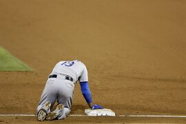 Los Angeles Dodgers' Hanley Ramirez takes a minute to get up after injuring himself turning toward second base during the sixth inning of a baseball game against the San Diego Padres on Friday, Aug. 29, 2014, in San Diego. After review, Hanley was called out at first. (AP Photo/Gregory Bull)
