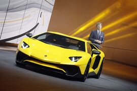 The President and CEO of Lamborghini Stephan Winkelmann introduces the new Lamborghini Aventador SV during a preview show of Volkswagen Group, as part of the 85th Geneva International Motor Show, Switzerland, Monday, March 2, 2015. (AP Photo/Laurent Cipriani)