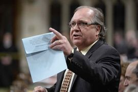 Aboriginal Affairs Minister Bernard Valcourt responds to a question in the House of Commons in Ottawa, Tuesday, Nov. 25, 2014.