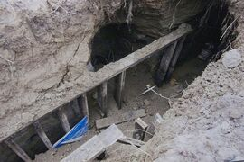 A copy of a Toronto Police photo of the site of the tunnel found near one of the venues for this year's Pan American games is shown during a press conference in Toronto on February 24, 2015. Police say they have identified and interviewed two men who built a tunnel near a Pan Am Games venue in Toronto and have determined there is no criminal intent or threat. Investigators say they received information on Friday that helped them to identify two men. THE CANADIAN PRESS/HO - Toronto Police