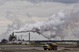 A dump truck works near the Syncrude oil sands extraction facility near the town of Fort McMurray, Alberta on Sunday June 1, 2014. For young Canadians looking to land a good job, the West is where it's at, according to a new report by the Fraser Institute.The right-leaning think-tank says Alberta and Saskatchewan offer the best opportunities for to 25-to-34 set. THE CANADIAN PRESS/Jason Franson