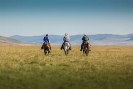 Three of the 72 ranchers who agreed to a huge conservation deal on more than 12,000 hectares of native southern Alberta grassland ride off toward the Rocky Mountain foothills. The deal, announced Monday, Sept. 29, 2014 will keep the wildlife-rich land free of housing and agricultural development and allow the ranchers to graze cattle and retain ownership. THE CANADIAN PRESS/ho-Kyle Marquardt.