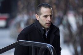 Alexander (Sandro) Lisi arrives at court in Toronto on Friday, March 6 2015. A Toronto police officer is testifying about the day he helped arrest Rob Ford's driver.The officer says Lisi had $900 in police drug-buy money on him that day in October 2013. THE CANADIAN PRESS/Chris Young